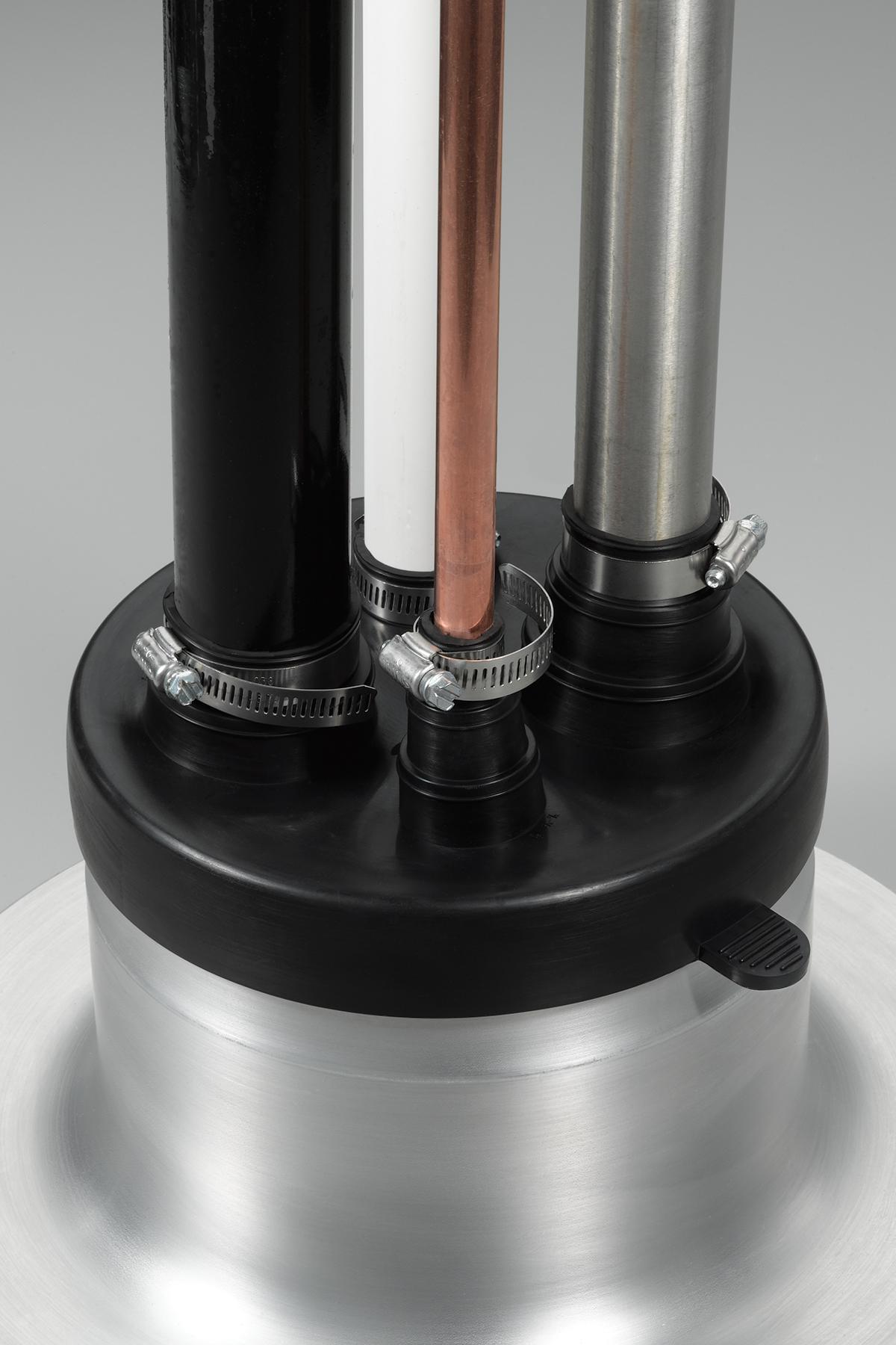 Universal Boot Accommodates Up To Four Pipes Of Various