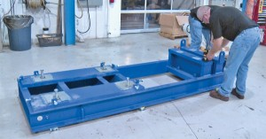 Photo: Benchmark Maintenance Services. Measuring for flatness on a two-level steel bed.