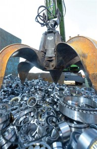 Photo courtesy Shaeffler AG. A big claw was used to lift the fake bearings into a scrap press.
