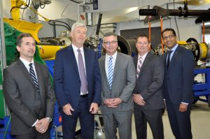 From left to right, inside the new test cell, are: Steve Tully, Director Supply Management, Contracts & Real Estate – Jazz Aviation LP; Declan O'Shea, President and CEO of Vector Aerospace; The Honourable J. Heath MacDonald, Minister of Economic Development and Tourism - PEI Government; Jeff Poirier, President of Vector's Engine Services – Atlantic division; and Satheeshkumar Kumarasingam, Senior VP Commercial Services - Pratt & Whitney Canada