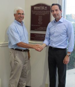 Handshake between Hollis White (left), founder of White Drive Products, Inc., and Eric Alström, President of Danfoss Power Solutions