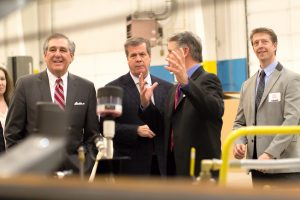 Des-Case President and CEO Brian Gleason explains the process of manufacturing fluid handling equipment to Jerry Abramson, left, deputy assistant to the President of the United States and director of intergovernmental affairs, and his entourage in a March 2015 tour of the Des-Case plant. Former Nashville Mayor Karl Dean accompanied Abramson on the tour. Des-Case has consistently been cited as an aggressive global exporter of its products.